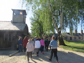 Students from Cohort V took a Study Tour to Poland. This photo was taken when they entered the infamous gates of Auschwitz.