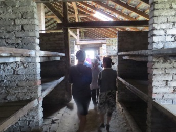 Students, Anat and Tutti, walk through a barrack at Birkenau, this was a family barrack meant for children.